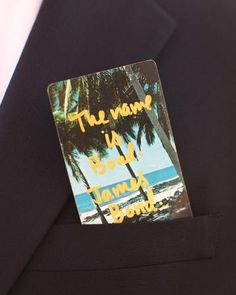 Cocktail servers handed out vintage beach-themed playing cards that the bride had inscribed in gold with quotes from 007 films