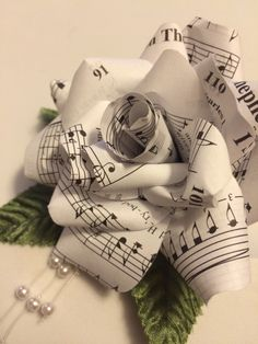 Paper Flowers made from sheet music. These were made for a wedding from southern gospel convention songbooks.