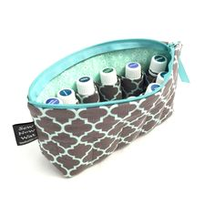 Essential Oil Case, Free Shipping to U.S., Medium Aqua and Charcoal Quatrefoil, 11 sleeves, baby blue ribbon zipper pull by SewNowWat on Etsy