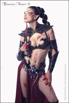 http://fc03.deviantart.net/fs70/f/2011/203/5/c/dark__elf__witch_by_i_tavaron_i-d41aeez.jpg