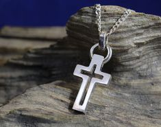 Handcrafted Cross in Sterling Silver (Sterling stamped on back) Measures 1-1/4 long by 3/4 inches wide and is 1/8 inch thick. Weighs 18 grams of solid sterling silver !. Cross comes on 16 inch sterling silver chain. I handcrafted this cross using the lost wax method of jewelry design. The cross is carved by hand in hard wax and set in plaster. This gets heated to a high temperature in a burn out furnace for a few hours then the sterling silver is melted with a torch and poured ...