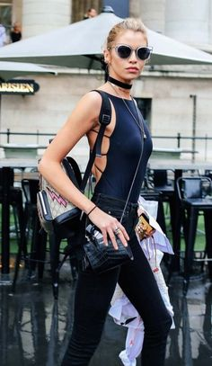 Stella Maxwell with a Gucci backpack.