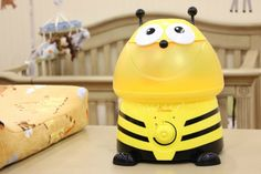 Humidifiers are a must-have in the nursery and this bumble-bee humidifier from @CraneUSA is the perfect accent in a yellow nursery!