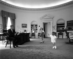 President Kennedy with his children in the oval office, 1962, Cecil Stoughton
