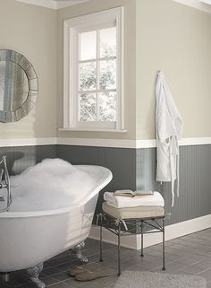 Benjamin Moore colors Elmira White HC-84 (upper walls) & Whale Gray 2134-40 (lower walls). Trim BM White Dove OC-17
