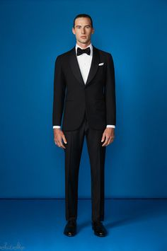 suitshop:    Classic and elegant s130 merino dinner suit with satin facing woven in Biella. Worn with a white Egyptian cotton dinner shirt and a silk bow tie.