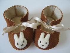 brown and cream baby booties with Miffy motifs