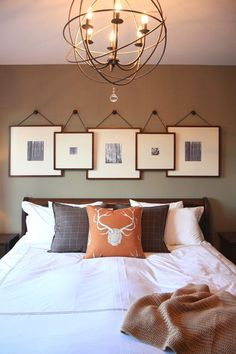 layered art above bed - overlapping frames hung from knobs - really like this idea