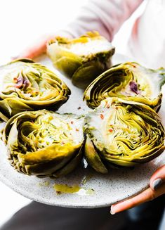 Instant Pot Steamed Artichokes with Mediterranean Aioli are not only easy to make, but delicious and nutritious! Quickly pressure cook for steamed artichokes in just 10 minutes. A paleo low carb vegetarian dish your family will love! Vegan options too!