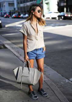 New Balance with shorts and Celine bag.