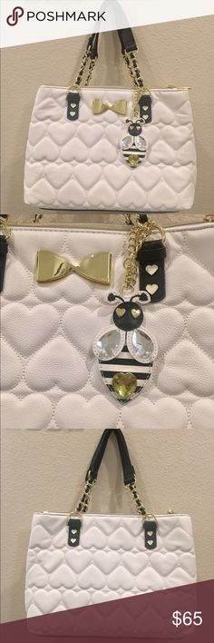 👑🐝Betsey Johnson Queen Bee Bag👑🐝 NWT. Signature white quilted hearts with black base. Black/gold chain straps. Gold metal bow and white/gold metal hearts detail this perfectly.💖 Signature black fabric with pink lips line the interior. Inside is separated into 2 sections with magnetic snap closure. 3 inside pockets with easy cell phone access. 2 outside zipper sections turn this into a 4 sectioned purse to keep your belongings perfectly organized👌🏼For you serious Boss Babes💋Amazing…