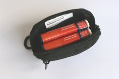 Allergy Apparel - Auvi-Q Carry All, $32.95 (http://www.allergyapparel.com/auvi-q-carry-all/) INSULATED! Versatile.  Clip it to your purse, wear on your own belt, or wear it with the included adjustable belt.