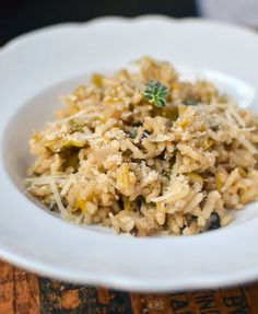 Mushroom and Leek Risotto - because I am a purist, I would finish this dish with a few dots of butter and 1/4 cup of Parmesano Reggiano - it uses both fresh and dried mushrooms and sounds amazing.