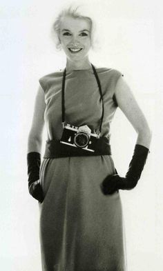 Marilyn with a Nikon F. Photo by Bert Stern, 1962.