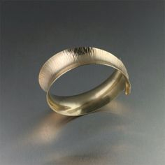 John S Brana...an amazing local jeweler in San Fran. I want this cuff!  http://www.johnsbrana.com/fine-jewelry-collections/14k-gold-chased-cuff.html