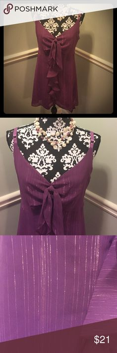 """Flirty Lane Bryant Purple Shimmery Tank Brand Lane Bryant. Size 20. 97% polyester/3% metallic fiber. Lining 100% polyester. Adjustable straps. Side zip. Bust 22"""" laying flat. Length 30"""" shoulder to front hem. Side hem hangs lower due to handkerchief cut. Perfect for a fun night in the town or just to dress up a pair of jeans! Lane Bryant Tops Tank Tops"""