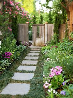Add Windows If your space is small, create windows, as seen in this gate, and vary the height of your plants or structures. That will give the area some visual relief -- and give your yard a playful quality.