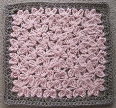 """Crocheted in the round like a granny square, this textural beauty will remind you of an endless field of flowers. Worked primarily in treble crochet, three rows of border will bring it up to 12"""".Could also be used as a pillow top or work it up in cotton for a dishcloth.Pattern support on my Ravelry board.See all my designs at my LoveKnitting store."""