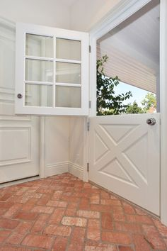 Add a Dutch door. If you have the option, a Dutch door (in which the top and the bottom part of the door operate separately) can add a distinctly English cottage feel. It also keeps kids and pets out of a workspace while still letting light and air in.