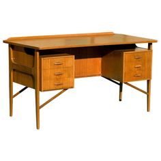 Danish Teak Desk in the Style of Kai Kristiansen | From a unique collection of antique and modern desks and writing tables at https://www.1stdibs.com/furniture/tables/desks-writing-tables/