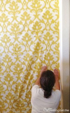 Using starch to wallpaper with fabric. Definitely doing this in my office, and possibly the laundry room.