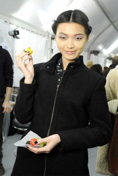 Model, macarons and subtle gray eyeshadow.