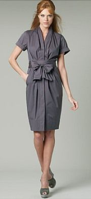 """Vogue 1220 """"Misses' Dresses and Belt""""  Description: Loose-fitting, mid-knee length dress has shawl pleated collar, partial waistline seam, pleats, side slant pockets, princess seams in bodice back, back darts, short sleeves with turn back cuffs, stitched hem facing, right fly front button closure and tie belt."""
