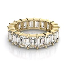 This 4.75ctw stunning 14kt yellow gold and emerald cut diamond eternity ring is an eye catching band. This diamond ring can easily make a woman's anniversary or special occasion one to remember. Visit our website to select metal and/or larger carat total weight. #diamondwave #eternityring #emeraldcutdiamond