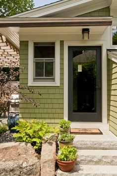 BACK ENTRY IS WELCOMING & CONVENIENT – These doors are painted on one side to withstand the weather and are fir wood on the interior providing easy access to the garbage and recycling shed off the side of the house. Green Exterior Paints, House Paint Exterior, Exterior Paint Colors, Exterior House Colors, Interior And Exterior, Cottage Paint Colors, Cottage In The Woods, Backyard Retreat, Craftsman Bungalows