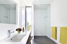 Shower screen, grey floor tiles, white wall tiles, wooden vanity. Aesop (heheh)