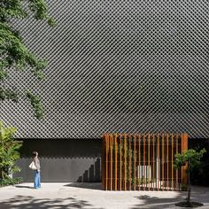Rio office block fronted by perforated metal and plants