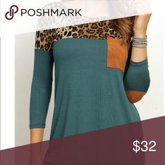 Brand New Hunter Green Leopard Top with patches Brand new. Hunter Green Leopard Top with Elbow Patches. This runs true to size. The sleeves are tight fitting. The Leopard material is a heavy weight material. The bottom is Rayon and Spandex. These are USA made. Tops Tunics
