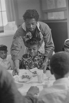 Charles Bursey serving children at Black Panther Free Breakfast for Children Program, St. Augustine's Episcopal Church, May 19, 1969.  Photo credit: Ruth-Marion Baruch / University of California, Santa Cruz