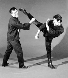 Bruce Lee and Dan Inosanto Instructions On Self Defense. Round house kick with guarded hand positions, one lower guard for groin area and other upper guard for facial head area while delivery kick.