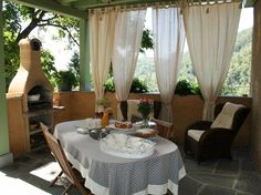 A house in the mountains above Versilia, with a furnished covered terrace, comfortable chairs and a barbecue - and a great view!