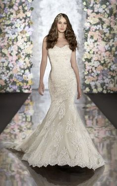 Beautiful vintage wedding dress offers corded lace and tulle over a Dolce Satin trumpet gown. Exclusive designer vintage wedding dress by Martina Liana.