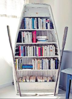 DIY Shelves Ideas : Upcycle Us: Upcycling old boat into bookshelf https://diypick.com/decoration/furniture/diy-shelves/diy-shelves-ideas-upcycle-us-upcycling-old-boat-into-bookshelf/