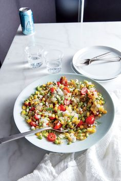 Feta-Herb Edamame Succotash | We're ready for the glories of summer produce, but since it's not quite the season, frozen vegetables and year-round grape tomatoes do the job wonderfully. Edamame replaces lima beans in traditional succotash for a boost of plant-powered protein. Feta adds a hit of salty tang, while fresh herbs lend an earthy flavor. This vibrant, vegetarian main comes together in a tasty 20-minute snap—though it also holds up well when prepared the night before.