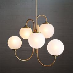Obsessed with this gooseneck chandelier from West Elm