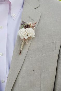 A pale lilac shirt and a boutonniere with an antique button.  Something for the Boys! | OneWed