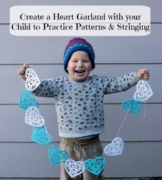 Make an easy heart garland with your preschool child to practice patterns and stringing (and decorate for Valentine's Day).
