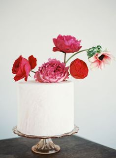 Pylon Cake created this elegantly simple confection, topped with a cluster of red blooms.   Photo by Chris Isham