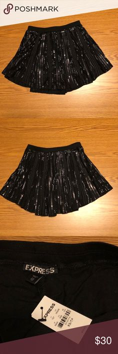 Express Black Glitter Skater Skirt Beautiful black glitter skater skirt from express. Built in shorts for modesty. NWT. No flaws. Express Skirts Circle & Skater