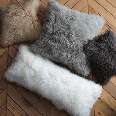 Mongolian lambskin fur pillows from West Elm. These look so amazing on a sofa or chair.