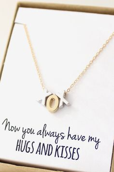 I would like this for Mother's Day :) Silver and Gold XOX Necklace Hugs and Kisses