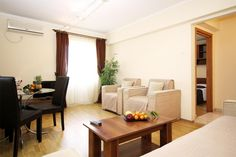 Corporate apartment in downtown Bucharest, perfect for monthly rentals, at University Square. It has fully-fitted kitchen, living room, bedroom and bathroom with jacuzzi tub. Free WiFi and bi-weekly cleaning are provided. Corporate Apartments, Bright Apartment, Weekly Cleaning, Jacuzzi Tub, Serviced Apartments, Bucharest, Best Location, Free Wifi, Living Room