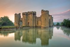 """""""Swans paddle around the lilies in the water-filled moat surrounding this most perfect-looking of medieval castles."""" Slow Travel Sussex; www.bradtguides.com"""