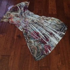 Summer dress, size 12/14 Predominantly Pale Blue with multicolored splashes of color.  The v neckline is embellished.  You will receive many compliments on this  summer dress. Apt. 9 Dresses Midi