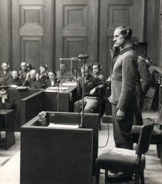 Karl Brandt, Adolf Hitler's personal physician, is addressing the court at the Doctors' Trial in Nuremberg. Brandt was key to the Nazi euthanasia program and other atrocities. He was convicted of war crimes and crimes against humanity and was hanged on June 2nd, 1948.