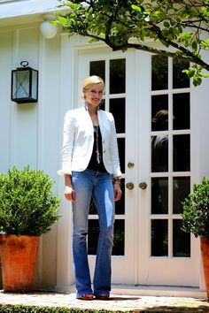 blue jeans, a navy tee and a white jacket!  with a pendant necklace